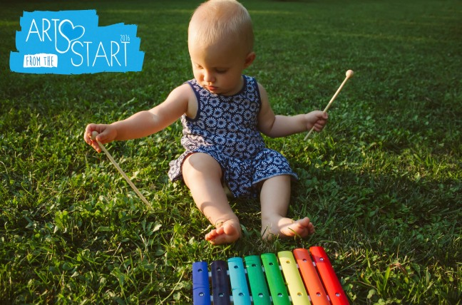 Baby play xylophone in the grass